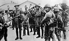 Some of the British, Australian, Indian and Chinese forces captured by Japanese forces during the fall of Singapore, 15 February 1942.