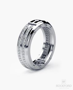 A classy and unusual design featuring a princess cut center diamond in this men's ring evokes opulent luxury, enhanced by very stylish Rockford screw accents and unique design flourishes. This men's d