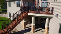 Custom Curved Trex Transcend Deck - Tiki Torch - built by Deckworks Cedar Valley, Cedar Falls, Iowa, a TrexPro Platinum Contractor