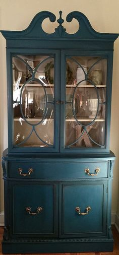 Vintage 1940s mahogany cabinet hand painted in Annie Sloan Chalk Paint, color Aubusson Blue & inside in Old Ochre. I also applied a dark wax to age it and clear wax to seal. All original hardware. The doors have convex glass and are original. Loads of beautiful detail on this piece! The top has two shelves for displaying and bottom opens to two tier storage. Measures: 77h x 37w x 16.5d. This item is for local pick up only. I cannot ship. Located just outside of Philadelphia. Close to I-95...