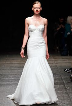 The prominent seams on a Hayley Paige wedding gown outline a corset detail on the Swiss dot fabric.