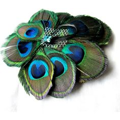 Turquoise French Birdcage Veil with Peacock Bridal Feather Fascinator ❤ liked on Polyvore