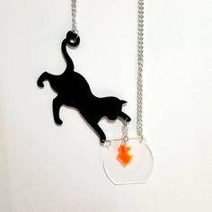 Cat and Goldfish Bowl Acrylic Necklace. One-of-a-kind acrylic necklace with black cat lifting a goldfish from its bowl. Cat Necklace, Necklace Price, Pendant Necklace, Cat Jewelry, Jewelry Design, Unique Jewelry, Ceramic Jewelry, Plastic Jewelry, How To Make Beads