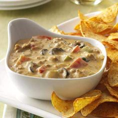 """Hearty Taco Dip Recipe- Recipes """"I created this dip by accident one day when I wanted to make a taco casserole but discovered I didn't have all the ingredients,"""" writes Claudia Jacobsen from Luverne, North Dakota. Dip Recipes, Baby Food Recipes, Meat Recipes, Mexican Food Recipes, Vegetarian Recipes, Cooking Recipes, Vegan Meals, Healthy Recipes, Appetizer Dips"""