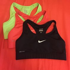 3 S Nike Pro Sports Bras 3 Nike Pro Sports Bras, perfect condition. Size small. Don't fit very well, I wear a medium. One neon green, one black, and one a dark coral/pink color. Will sell separate if requested. Nike Other