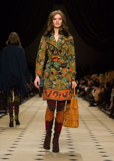 A cotton gabardine floral printed trench coat, with a The Bucket Bag and over-the-knee boots. Discover the collection at Burberry.com
