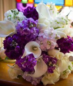 Elegant lilies, more #bouquets at www.BrideSTL.com