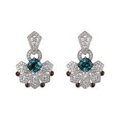 Cartier earrings Platinum, two cushion-shaped blue tourmalines totaling 5.17 carats, cabochon-cut yellow sapphires, brilliants.