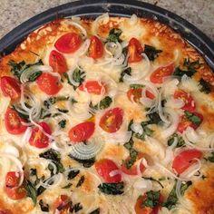 Pizza de tomates cherry con queso de cabra