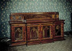 J.P. Seddon (1827-1906) designed this architect's desk, including the metalwork and inlay, in 1861 for his own use. Seddon had the desk made at his father's cabinet-making firm. He also commissioned ten painted panels depicting the Fine and Applied Arts from Morris, Marshall, Faulkner & Co.  Design & Designing Ford Madox Brown (1821-1893), who also designed the panel representing 'Architecture', suggested the overall theme. The 'Painting' and 'Sculpture' panels were by Edward Burne-Jones…