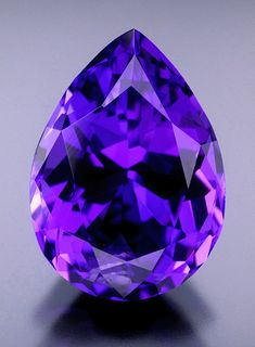 """ct pear-shaped tanzanite with exceptional bluish-violet color. The stone for Saint Germain; discovered in the mountains of Tanzania in Tiffany & Co gave the name """"Tanzanite"""". Minerals And Gemstones, Rocks And Minerals, Images Gif, Bing Images, Tanzanite Gemstone, Purple Love, Purple Things, Deep Purple, Rocks And Gems"""