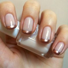 Nude nails with rose gold on the tips. This is the perfect neutral nail look with a bit of a feminine touch.