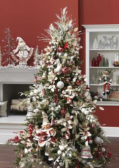 prettiest Christmas tree decoration balanced silver and red