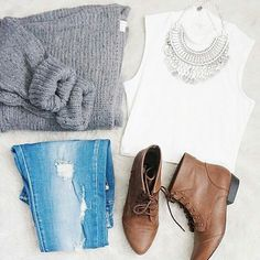 Grey sweater , white sleeveless cropped shirt , denim , statement necklace , brown ankle boots