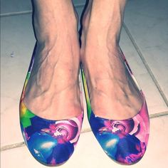 Jil Sander floral flats. Super cute. Size 40. Jil Sander floral flats. Super cute. Size 40. Fit is 9.5. I wear 10 and they are a bit too tight. Never wore outside the house. Sticker stains on sole and interior but otherwise like new. Comes with box.  Retail $375 but these were bought at $149.  Comes with box that indicates retail value and price paid. Jil Sander Shoes Flats & Loafers