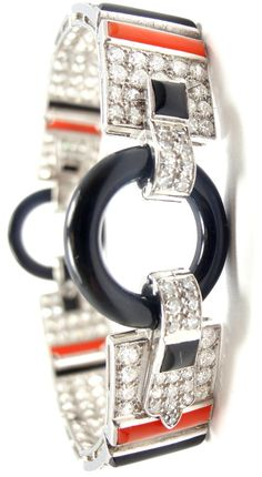 CARTIER ART DECO BRACELET~ Platinum set with Diamonds, onyx, and coral.