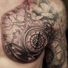 eine weiße taube, eine große weltkarte und ein großer schwarzer kompass idee für einen compass tattoo für mann