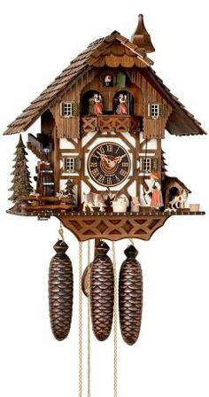 Reloj cucú Casa de la selva negra, rueda de molino. Fabricante: Hönes Altura: 43 cm. / 16,9 pulg. Ancho: 32 cm. / 12,6 pulg. Profundidad: 22 cm. / 8,7 pulg. Color: Nogal Peso bruto: 8,5 kg