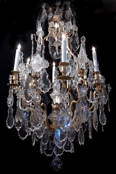 LA-5274  50''H 29''Diam French Louis XV dore bronze and crystal chandelier.   19th century.  8 lights