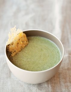 Baking grated Parmesan cheese in thin rounds results in thin, crispy wafers, or fricos, which add both texture and flavor to a velvety broccoli soup.