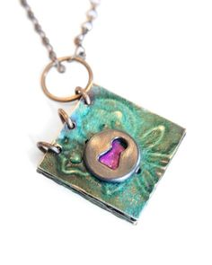 Altered journal necklace created with Vintaj