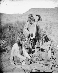 Group of Three Paiute men Starting Fire, All in Native Dress; Two Holding Bows and Arrows - Hillers - 1873