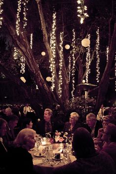 Hang icicle light strands from tree branches to light up your outdoor soiree.    Image via  Weddbook .