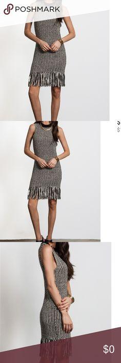 Sleeveless Knit Sweat Midi Dress Midi Boho Chic A fun fashionable Midi Dress. Sleeveless, round Neckline, Fringed Hemline multi colored. A great transition from summer to fall. 080220171675369 Dresses Midi