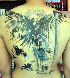 Great watercolor tattoo of ravens on the back.