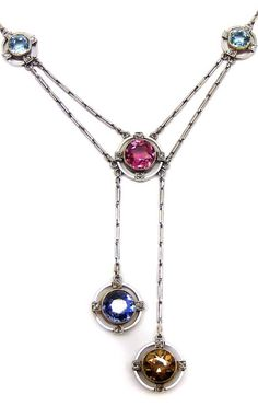 Gem and diamond pendant necklace, c.1910 , the fine bar-link platinum chain, set with two round-cut aquamarines and one pink tourmaline, each millegrain-set with rose-cut diamonds at their cardinal points, suspending two similarly set pendant drops, one sapphire and one golden zircon