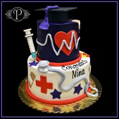 This two tier butter cream specialty cake with fondant accents was custom made to commemorate Nina's accomplishment. This medical school graduation cake is embellished with a 3D fondant silver stethoscope, fondant band aids, and a fondant syringe. Adding a finishing touch, we crafted a fondant graduation cap and created an edible heart monitor for the center of the top tier.