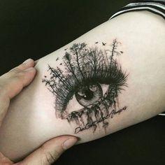 Surrealist forest eye tattoo on the right inner arm. Tattoo artist: Hongdam
