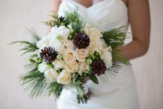 Bōm Photography; what a gorgeous winter bouquet, with a nod towards the couple's love of the outdoors
