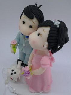 #Wedding Cake topper.   This is an example of a custom made Wedding Cake topper that I created, #Groom pulling Bride. I can customize the dress and tux just for you!   Fo... #wedding #bride #groom #marroriage #marriage