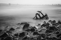 Andrew Nimmo Photography posted a photo:  A long exposure photograph of the surf breaking over an abandoned and decaying buoy at the mouth of the River Tees.  One of those times when I liked the foreground but didn't really like the background. The rocks gave me a good solid anchor with their rugged edges and the play of light on the wet surfaces. The buoy had a lovely hard edged skeletal feel to it too, so what better way to contrast the hard edges then to ghost the surf and tweak my depth…