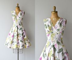 Vintage 1950s very pale pink cotton dress with large and expressive floral print, high, surplice gathered bust, wallpaper waist that is nice and fitted as it moves into a very full panel constructed skirt. Metal back zipper.   brand/maker: Toni Todd