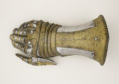 Gauntlet for the Right Hand, ca. 1550–60. Italian, Milan. The Metropolitan Museum of Art, New York. Bashford Dean Memorial Collection, Funds from various donors, 1929 (29.158.215) | This gauntlet is finely decorated with trophies or panoplies of arms, consisting of armor parts, weapons, musical instruments, and ribbons arranged in bands and set on a dotted ground.
