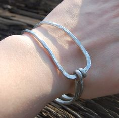 This bangle is handcrafted with very thick, sturdy 9 gauge aluminum wire.      Please note that bangle bracelets slide over the hand and fit