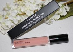 """MAC lip glass in """"boy bait"""".  Wear it almost every day,- Im SOO Addicted to this stuff!"""