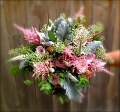 Beautiful wild bouquet of Quick sand roses, cream veronica, pink astilbe, seeded eucalyptus, peach spray roses, dusty miller and boxwood. Stunning!