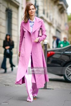 Aymeline Valade wears a pink coat, pink flare pants , outside Valentino, during Paris Fashion Week Womenswear Spring/Summer 2018, on October 1, 2017 in Paris, France.  (Photo by Edward Berthelot/Getty Images)