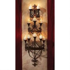 Carbonne Candle Chandelier Wall Sconce $119.00 This would be great on the wall between the great hall and the bedroom.