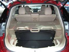 2014 Nissan Rogue's Cargo System Made for Family Life | News | Cars.com 2014 Nissan Rogue, Tonneau Cover, Reusable Grocery Bags, Honda Cr, First Aid Kit, Flooring Options, Fuel Economy, Shopping Spree