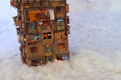 a few stories above the clouds in this diaroma of a hanoi housing complex by nguyen manh hung (photo by christy gallois)
