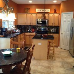 Burnt orange kitchen with new tile flooring