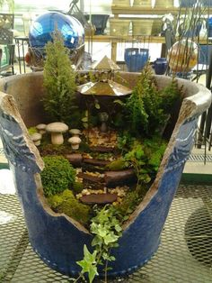 Fairy garden in a broken pot This one is blue for a different look.