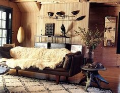 Cowhideand wood, bamboo and wool, a crow and even a Serge Mouille lamp!