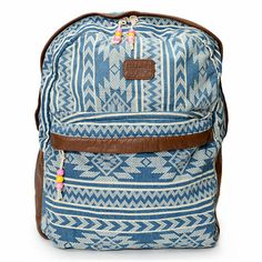 "From school to the beaches and back again, the Billabong Burning Up denim backpack for girls has your travel and style needs covered. Coming in a Blue Denim with White tribal print throughout, this backpack features a large main compartment with padded laptop sleeve that fits tablets or laptops 12"" and under, an exterior zipper front pocket and a padded back panel and adjustable shoulder straps for comfort. With brown faux leather trims and bead detailing at the zipper pulls, the Burning Up…"