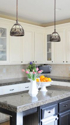 Step by Step tutorial on how to add glass to a kitchen cabinet. My Uncommon Slice of Suburbia The lights are amazing.