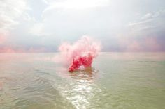 Filippo Minelli takes journeys into wild landscapes, empty churches, and abandoned parking lots where he sets off smoke bombs that release vibrant bursts of color into the omnipresent silence.